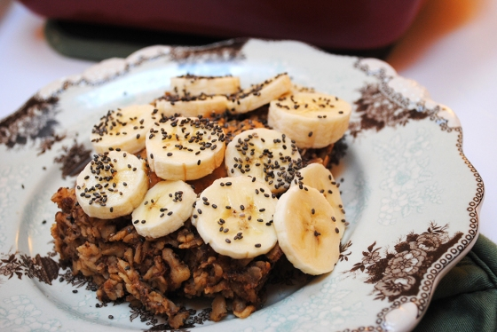 Baked oatmeal topped with peanut butter, banana, and chia seeds