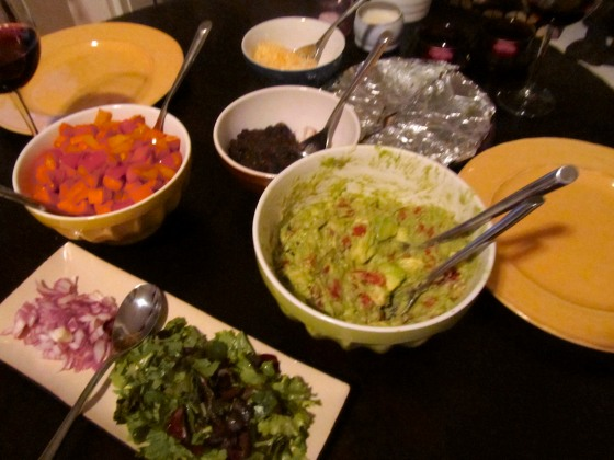 Guacamole, Chopped lettuce and onions, Roasted Veggies, Black Beans, Cheese, and Tortillas