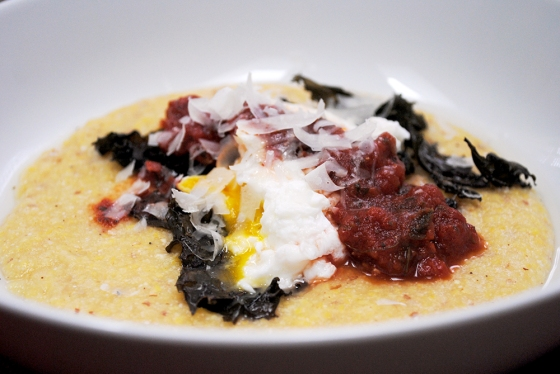 "Runny yolk, crispy kale, tomato sauce with a slight ""kick"""