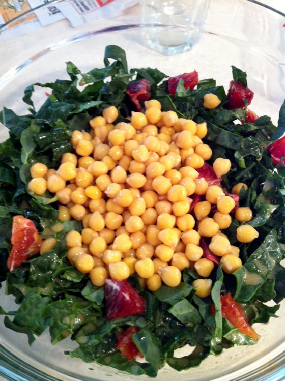 Combine sliced kale, chopped orange, and chickpeas